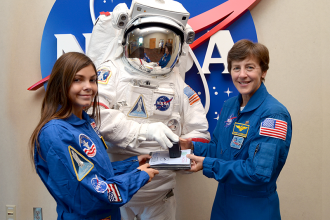 Alyssa gets the last stamp on her NASA Passport from former astronaut Wendy Lawrence.