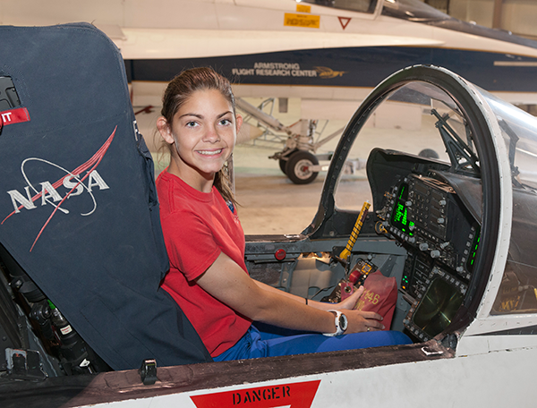 Alyssa sits in an F/A-18 cockpit during a special tour of NASA Armstrong.